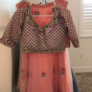 Stonework heavy lehenga peach and dusty color